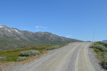 Gravel road in Norwegian mountains