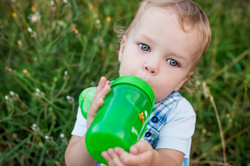 cute toddler boy drinking