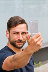 Young man making a selfie