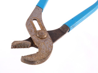 Close up of  old rusty pliers on a white background.