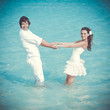Just married couple in the sea
