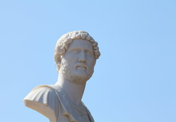 marble bust on a background of blue sky