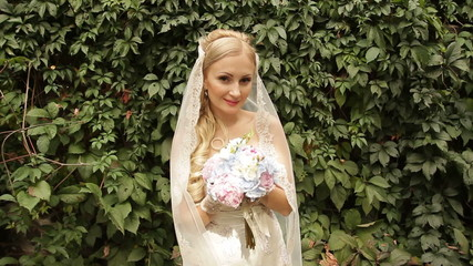 The bride at the ivy-covered walls