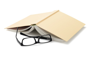 Spectacles Beside Inverted Book