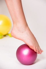 Closeup portrait of a foot rolling a physio ball