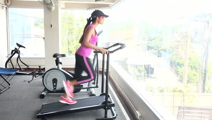 woman running in a gym machine
