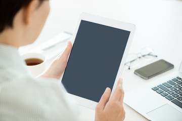 Woman with blank digital tablet