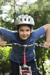 Portrait of a child riding bicycle