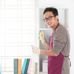 Asian man housekeeping