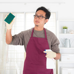 Asian man doing house chores