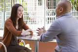 interracial couple meeting on a casual first date outdoors poster