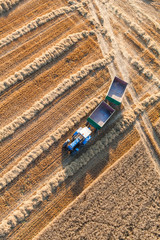 aerial view of tractor on harvest field