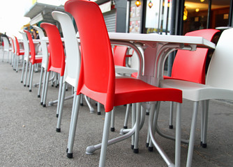 Red and white chairs with tables in an cafe