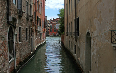 narrow navigable  channel of water in the splendid city of Venic