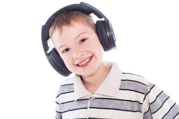 The young boy  listening to music