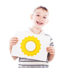 Happy boy with gear-wheel sign