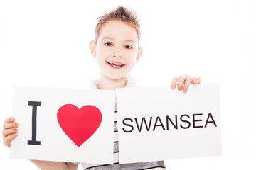 Boy with Swansea city sign