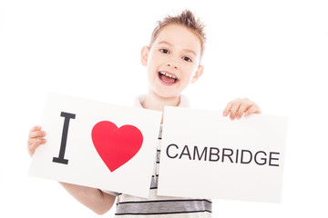 Boy with Cambridge city sign