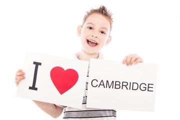 Boy with Cambridge city sign