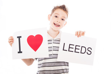 Boy with city sign Leeds