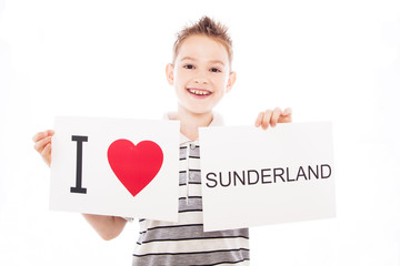 Boy with Sunderland city sign