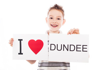 Boy with Dundee city sign