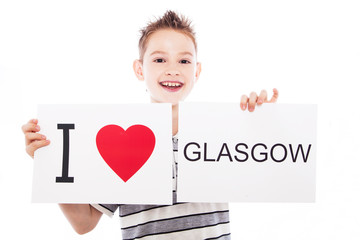 Boy with Glasgow city sign