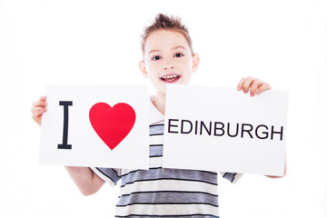 Boy with Edinburgh city sign