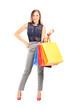 Trendy girl holding shopping bags