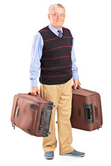 Senior gentleman carrying two bags