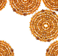 Abstract composition of raw amber gemstones on white.