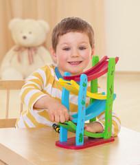boy playing toy.