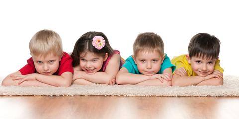 Four children on the white carpet