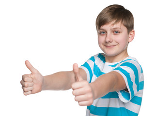 Teen boy holds his thumbs up