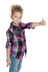 Confident young girl holds her thumbs up