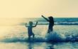 kids on the beach at sunset