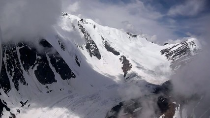 Stock Video Footage Flying through the clouds glacier mountain