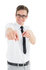 Geeky young businessman pointing at camera