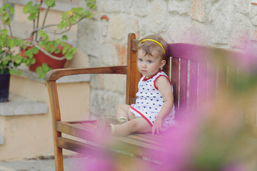 Girl on Wooden Bench