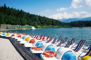 Paddle boats in Lavarone Lake. Italy.