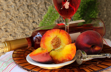 Still life with bottle,  glass of wine and peaches .