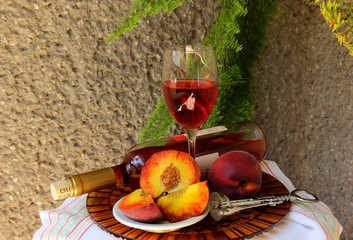Still life with bottle  of wine,  glass of wine and peaches .