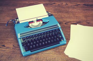 old fashioned blue typewriter