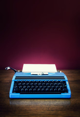 blue typewriter on desk