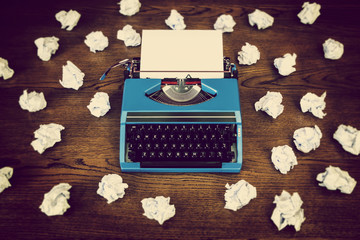 retro typewriter screwed up paper