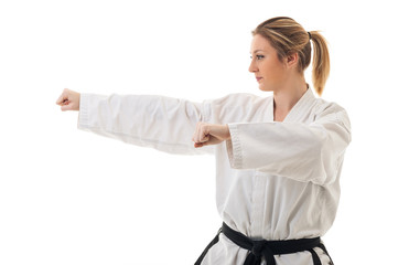 Blonde martial arts girl in kimono exercising taekondo. Studio i