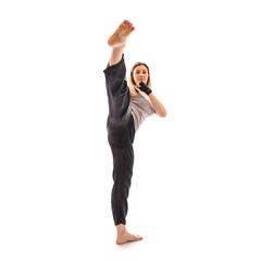 Blonde martial arts girl exercising taekondo. Studio isolated po