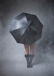 anonymous girl covering with black umbrella
