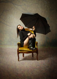 girl with umbrella looking for stop rain