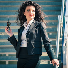 Business woman portrait outdoors with modern building as backgro